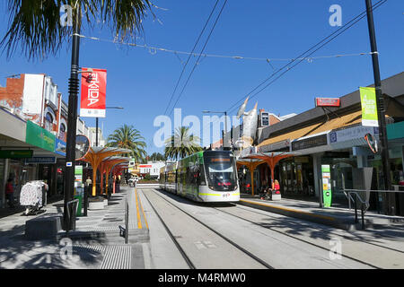 St Kilda, Melbourne, Australia: March 07, 2017: An electric tram leaves the Acland Street tram stop in popular Acland - Stock Photo