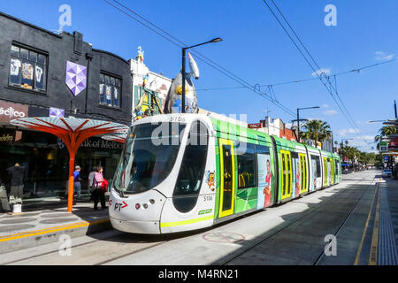 St Kilda, Melbourne, Australia: March 06, 2017: An electric tram arrives at the Acland Street tram stop in St Kilda. - Stock Photo