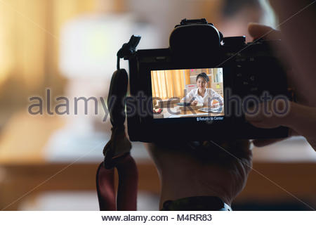 The photographer to pay close attention to take a photo - Stock Photo