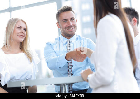 closeup. Manager shakes the hand of a woman client. - Stock Photo