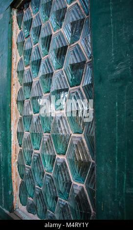 glass bricks relief green window trim - Stock Photo