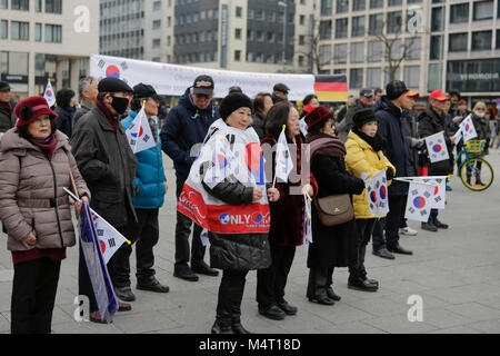 Frankfurt, Germany. 17th February 2018. People are pictured at the rally, holding South Korean flags. South Koreans - Stock Photo