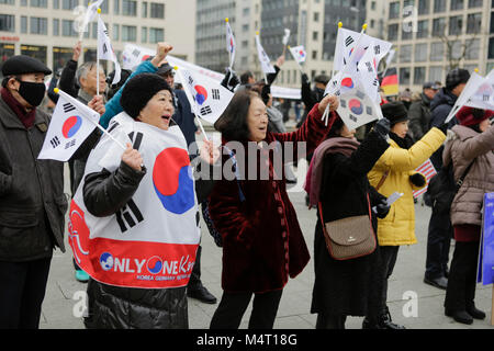 Frankfurt, Germany. 17th February 2018. People are pictured at the rally, weaving South Korean flags. South Koreans - Stock Photo