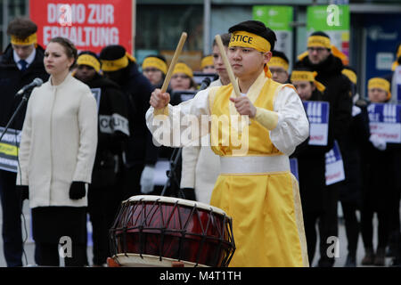 Frankfurt, Germany. 17th February 2018. A Korean drummer in a traditional dress performs on a buk, a traditional - Stock Photo