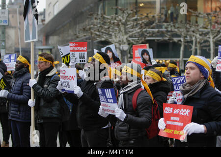 Frankfurt, Germany. 17th February 2018. Sympathisers of the Human Rights Association for Forced holds up signs that - Stock Photo