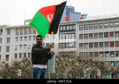 Frankfurt, Germany. 17th February 2018. A protester waves a flag of the Kingdom of Afghanistan. Afghans and German - Stock Photo