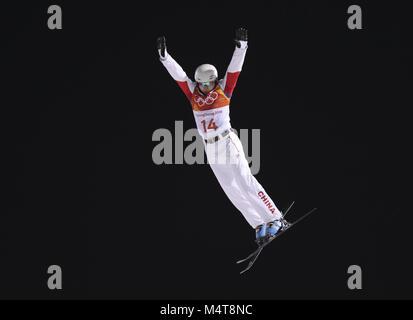 Pyeongchang, South Korea. 18th Feb, 2018. Liu Zhongqing of China competes during men's areials final of freestyle - Stock Photo