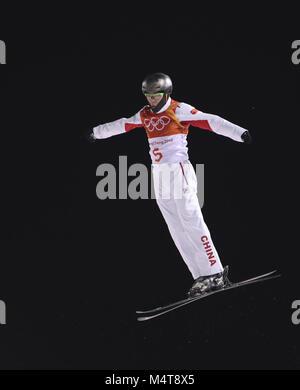 Pyeongchang, South Korea. 18th Feb, 2018. Qi Guangpu of China competes during men's areials final of freestyle skiing - Stock Photo
