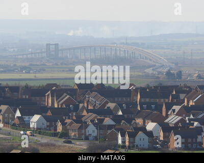 Minster on sea, Kent, UK. 18th Feb, 2018. UK Weather: another sunny and warm day in Minster on sea on the Isle of Sheppey in north Kent. The Sheppey Crossing. Temp: 10c. Credit: James Bell/Alamy Live News