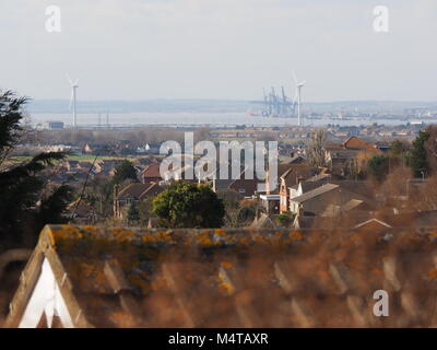Minster on sea, Kent, UK. 18th Feb, 2018. UK Weather: another sunny and warm day in Minster on sea on the Isle of Sheppey in north Kent. Temp: 10c. View towards London Thamesport. Credit: James Bell/Alamy Live News