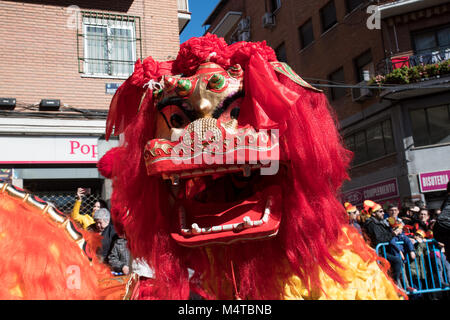 Madrid, Spain. 18th February, 2018. Detail of the face of a dragon during the Chinese New Year parade in Madrid. - Stock Photo