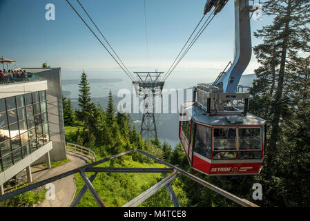 North Vancouver, British Columbia, Canada.  Grouse Mountain Skyride at the top with view of Burrard Inlet, Pacific - Stock Photo
