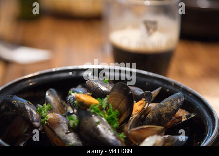 Mussels and Guinness - great Irish pub food. Clifden, County Galway, Ireland. - Stock Photo