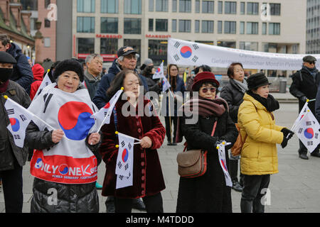 Frankfurt, Germany. 17th Feb, 2018. People are pictured at the rally, holding South Korean flags. South Koreans - Stock Photo