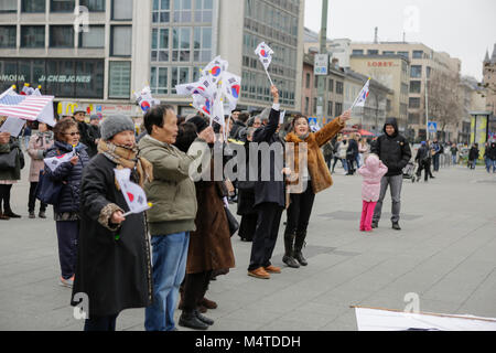 Frankfurt, Germany. 17th Feb, 2018. People are pictured at the rally, weaving South Korean flags. South Koreans - Stock Photo