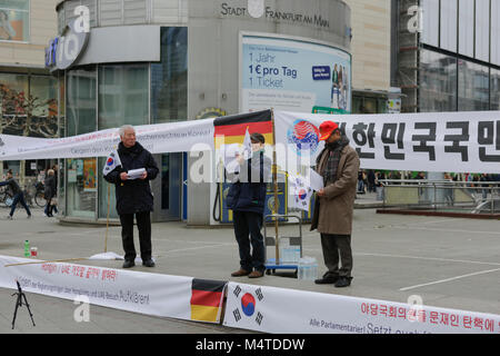 Frankfurt, Germany. 17th Feb, 2018. Speakers address the rally. South Koreans living in Germany protested in Frankfurt - Stock Photo