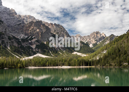 Mountain reflections at Lake Prags, South Tyrol, Italy - Stock Photo