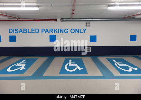 Car park with disabled parking zone sign - Stock Photo