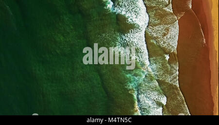 Aerial View From Flying Drone Of Ocean Waves Crushing On Beach - Stock Photo