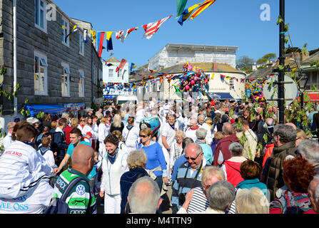 """the streets of padstow in cornwall, england, uk, are crowded with revellers during the annual may day """"obby oss"""" - Stock Photo"""