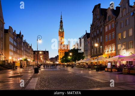 City of Gdansk in Poland at dusk, Old Town, historic houses on Long Market street (Polish: Długi Targ) - Stock Photo
