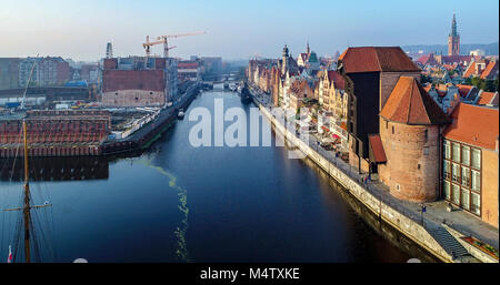 Gdansk, Poland. Old city with the oldest medieval port crane (Zuraw) in Europe, town hall tower, Motlawa River, - Stock Photo