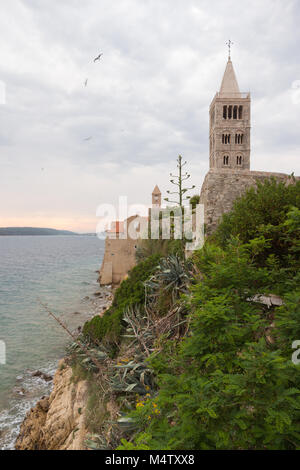 Shoreline view on Rab town with towers and fortifications - Stock Photo