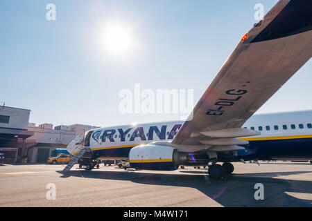A Ryanair Boeing 737-800 sits on the apron at Rome Ciampino airport after carrying passengers on a bright sunny - Stock Photo