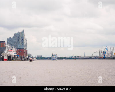 View from ferry at busy harbour day eastwards in harbor Hamburg. - Stock Photo