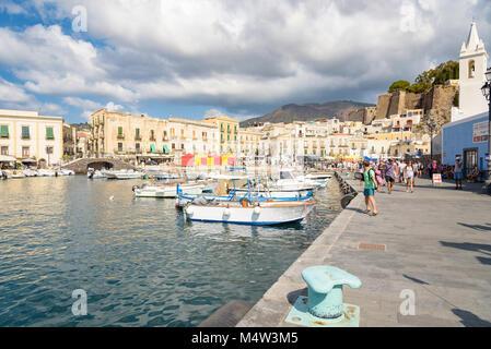 Lipari, Aeolian Islands, Italy - August 22, 2017: Tourists wait for their ship in Marina Corta on Lipari Island, - Stock Photo