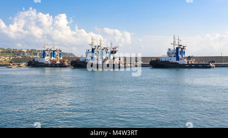 Tugs in the port of Milazzo, Sicily, Italy - Stock Photo