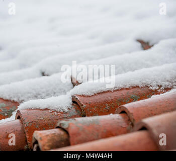 roof with ancient shingles covered in snow - Stock Photo