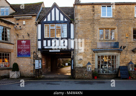 BOURTON ON THE WATER, UK - FEBRUARY 15th, 2018: Old houses and shops in Bourton-on-the-Water, which  is a village - Stock Photo