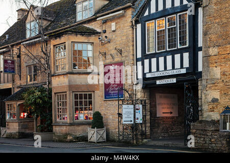 BOURTON ON THE WATER, UK - FEBRUARY 15th, 2018: Row of shops in Bourton-on-the-Water, which  is a village in Gloucestershire - Stock Photo