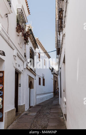 Cordoba, Spain - April 12, 2017: Old typical street in the jewry of Cordoba near Synagogue with white walls decorated - Stock Photo