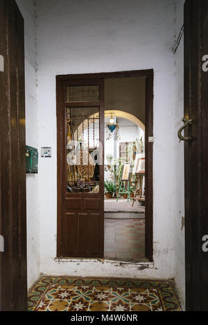 Cordoba, Spain - April 12, 2017: Entrance to old typical courtyard or patio in the Jewish Quarter of Cordoba - Stock Photo
