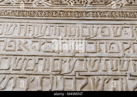 Cordoba, Spain - April 12, 2017: Ancient Hebrew inscriptions on the wall in the synagogue of Cordoba. - Stock Photo
