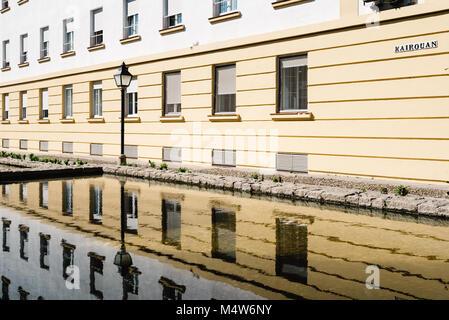 Cordoba, Spain - April 12, 2017: Reflections on water pond in Cordoba in jewish quarter. Kairouan street. - Stock Photo