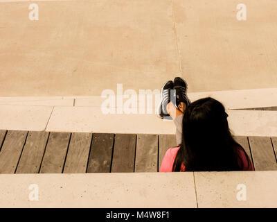 Tel Aviv, Israel.  Woman relaxing on the beach Tel Baruch in Tel Aviv. - Stock Photo