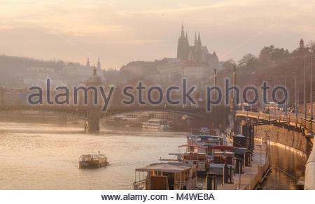 Coldy winter sunset over Charles bridge, Prague, Czechia - Stock Photo