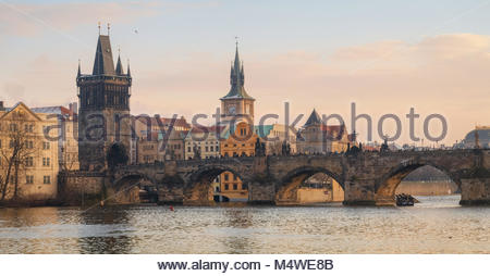 Coldy winter sunset over Charles bridge, Prague, Czechia - Stock Photo