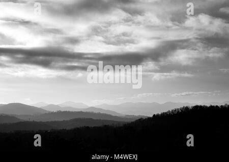 Clouds hover over the Blue Ridge Mountains in this view from the Omni Grove Park Inn in Asheville, NC, UAS - Stock Photo