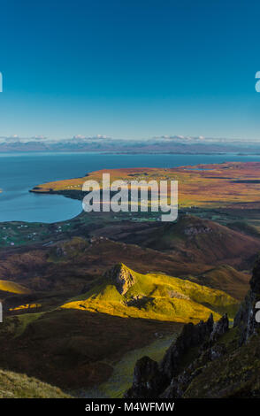 The Quiraing looking out over Staffin towards Torridon. - Stock Photo