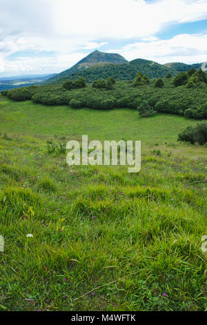 the volcano of thevpuy de dome seen from the volcano of the puy des goules in auvergne - Stock Photo