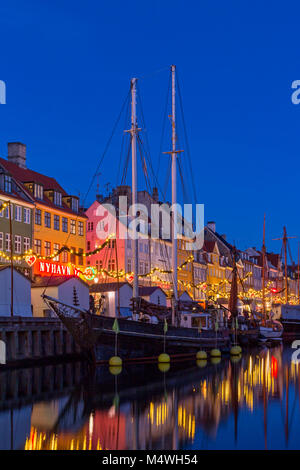 Christmas market along Nyhavn canal, Copenhagen, Denmark - Stock Photo