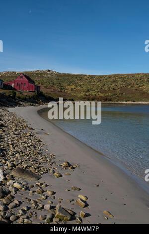 Falkland Islands, West Point Island. Private island, buildings along the rocky coast. - Stock Photo