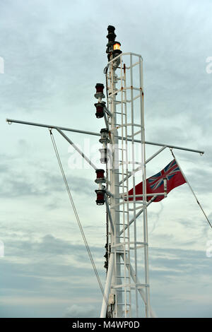 ships masthead and port and starboard navigation lights and red ensign or red duster flag. - Stock Photo