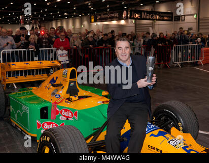 Nigel Mansell CBE posing  with the London Classic Car Show 'Icon' award,  in the Grand Avenue, after his drive in - Stock Photo