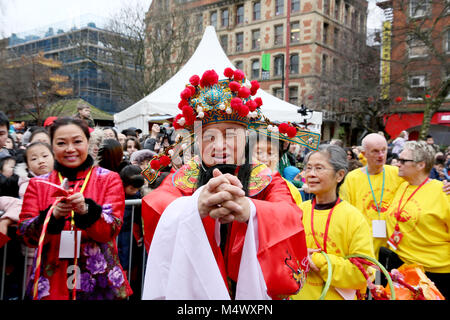 Traditional dressed Chinese man gives gifts out  in New Year Celebrations, Chinatown, Manchester, 18th February, - Stock Photo