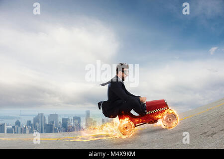 Fast businessman with a car wins against the competitors. Concept of success and competition - Stock Photo